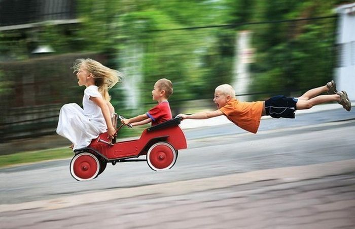 persistent kids flying downhill on a wagon